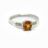 Solitaire saphir orange et diamants